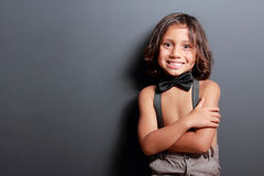 Cute little boy smiling with arm crossed Royalty Free Stock Images