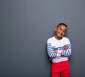 Cute little boy smiling with arms crossed Stock Photo