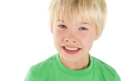 Cute little boy smiling at camera. On white background royalty free stock image