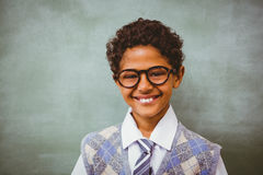 Cute little boy smiling in classroom Stock Image