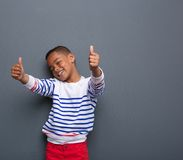 Cute little boy smiling with thumbs up sign Stock Images