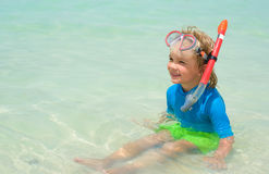 Cute little boy with snorkeling equipment at tropical beach Royalty Free Stock Photo