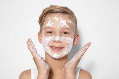 Cute little boy with soap foam on face royalty free stock photos
