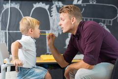 Cute little boy at speechtherapist session. Royalty Free Stock Photos