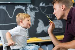 Cute little boy at speechtherapist session. Stock Image