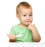 Cute little boy with spoon Royalty Free Stock Photos