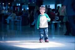 Cute little boy standing at airport Royalty Free Stock Image
