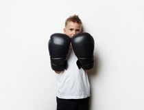Cute little boy standing in boxing gloves and he Royalty Free Stock Photo