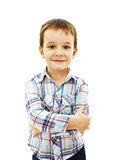 Cute little boy standing with folded hands Stock Photo