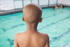 Cute little boy standing at the pool Stock Photography
