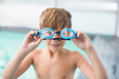 Cute little boy standing poolside Stock Photography