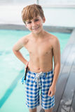 Cute little boy standing poolside Royalty Free Stock Photography
