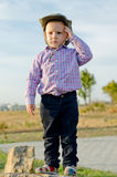 Cute little boy standing on a rock Stock Photography