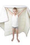 Cute little boy stands going to hide under blanket Royalty Free Stock Images