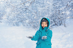 Cute little boy stands and keep your hands in front of him. A cute little boy stands and keep your hands in front of him in park in the winter Royalty Free Stock Photos