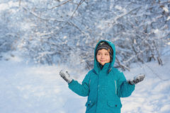 Cute little boy stands and looks towards. A cute little boy stands and looks towards in park in the winter Stock Photos
