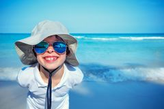 Cute little boy in sunglasses making selfie at tropical beach on exotic island Stock Photos