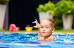 Cute little boy swimming on pool Royalty Free Stock Photos