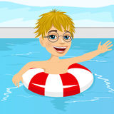 Cute little boy swimming in pool with inflatable ring Royalty Free Stock Image
