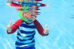 Cute little boy swimming underwater Royalty Free Stock Photography