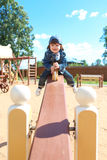 Cute little boy on swing Stock Photo