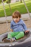 Cute little boy on a swing Stock Image