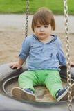 Cute little boy on a swing Stock Photos