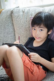 Cute little boy with tablet pc Stock Photography