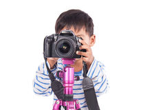 Cute little boy taking camera Royalty Free Stock Photography