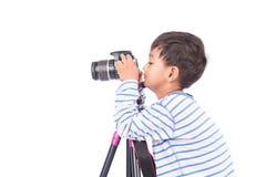 Cute little boy taking camera Stock Photography