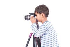 Cute little boy taking camera Stock Image