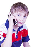 Cute little boy talking on cell phone. Isolated on white background Royalty Free Stock Photo