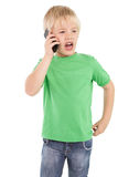 Cute little boy talking on smartphone Royalty Free Stock Images
