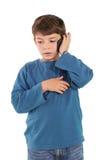 Cute little boy talking on smartphone Royalty Free Stock Photo