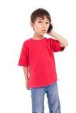 Cute little boy talking on smartphone Stock Photo