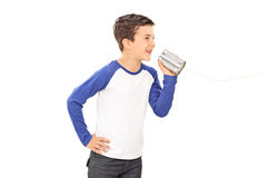 Cute little boy talking through a tin can phone Royalty Free Stock Photography