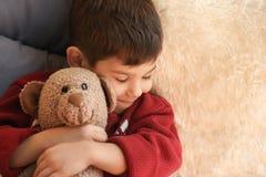 Cute little boy with teddy bear sleeping royalty free stock photo