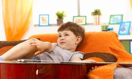 Cute little boy thinking on couch Royalty Free Stock Photos