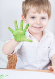Cute little boy of three years having fun painting Royalty Free Stock Images