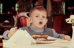 Cute little boy about to tuck into a slice of cake Royalty Free Stock Photography