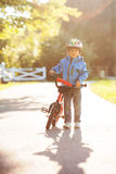 Cute little boy, toddler child, riding bike in a helmet Royalty Free Stock Photography