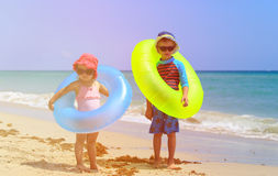 Cute little boy and toddler girl play on beach Royalty Free Stock Photo