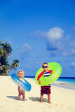 Cute little boy and toddler girl play on beach Royalty Free Stock Images