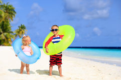Cute little boy and toddler girl play on beach Stock Images