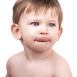 Cute little boy, tongue out. Close up portrait of cute little boy on white background, looking up, blue eyes Royalty Free Stock Photography