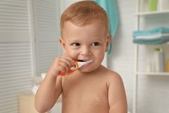 Cute little boy with toothbrush royalty free stock photo
