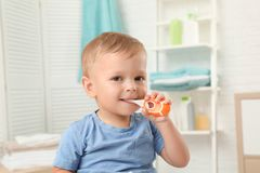 Cute little boy with toothbrush royalty free stock images