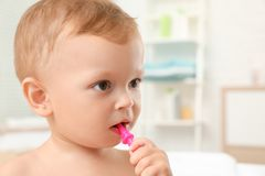 Cute little boy with toothbrush stock photography