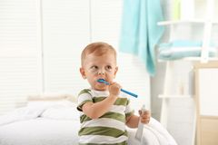 Cute little boy with toothbrush royalty free stock photography
