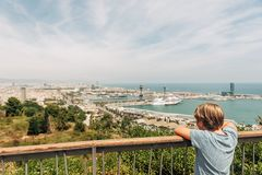 Outdoor summer portrait of young kid boy. Cute little boy tourist admiring Barcelona city from Montjuic hill, travel with children royalty free stock photo